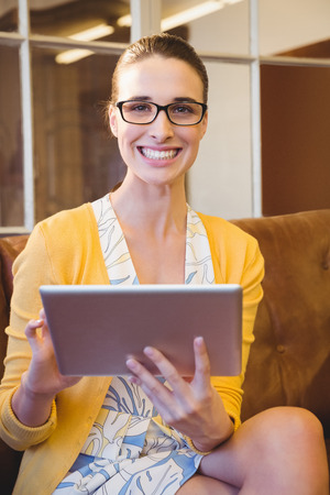 young businesswoman: Business woman looking her tablet at work