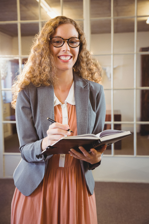 swivel: Business woman holding a book at work