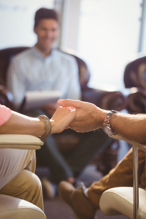 sitting on sofa: Focus on hands with couple at work