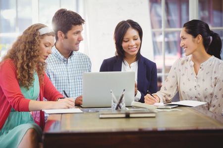 well dressed woman: Business people working together in office Stock Photo