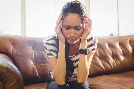 well dressed woman: Business woman is stressed because of work in office