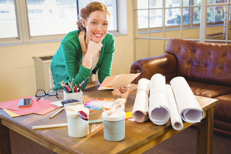 phoning: Business woman posing with her scheme at work Stock Photo