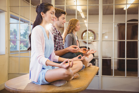 legs woman: Business people doing yoga together at work