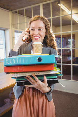 phoning: Business woman calling on the phone at work