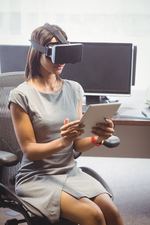 woman tablet pc: Business woman using 3D glasses in office Stock Photo