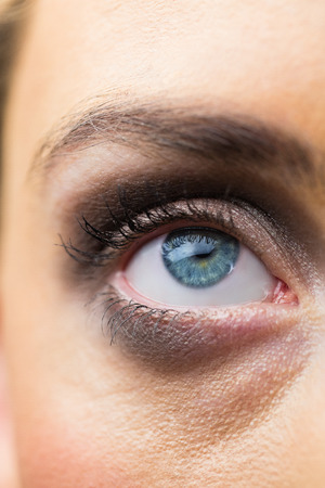 eyes opened: Focus on eyes makeup with opened eyes in a studio