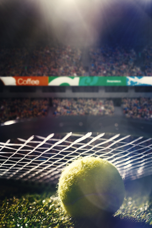 racket stadium: Close up of a tennis racket and ball in stadium