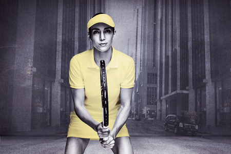 strret: Composite image of female athlete playing tennis against urban projection on wall Stock Photo