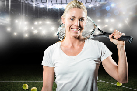 racket stadium: Composite image of portrait of female tennis player posing with racket in a stadium