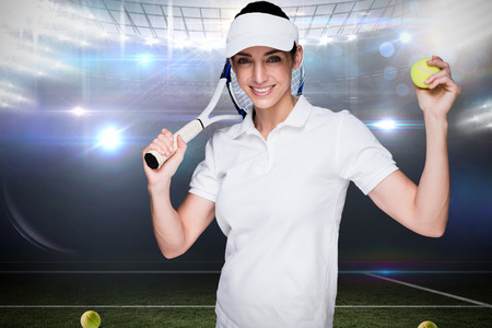 racket stadium: Composite image of female athlete holding a tennis racket and ball in a stadium