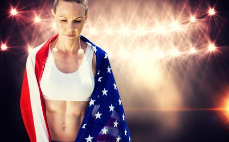 unsmiling: Portrait of american sportswoman unsmiling  against flash light Stock Photo