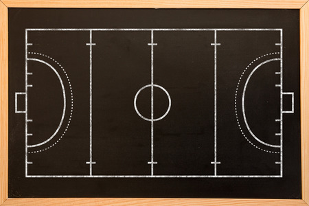 terrain de handball: Handball field plan on a black background against blackboard with copy space