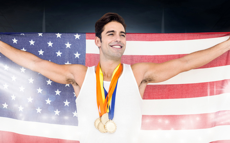 winning pitch: Athlete posing with gold medals and american flag after victory on a black background