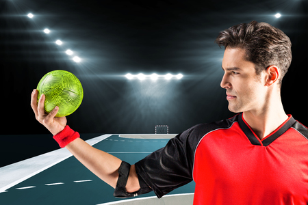 elbow band: Confident athlete man holding a ball  against handball field indoor Stock Photo