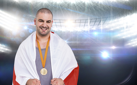 winning pitch: Athlete with gold medal against american football arena Stock Photo