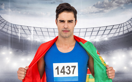 portugal flag: Athlete with portugal flag wrapped around his body against sports arena