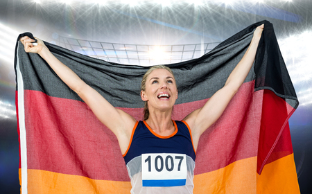 german flag: Athlete posing with german flag after victory against american football arena