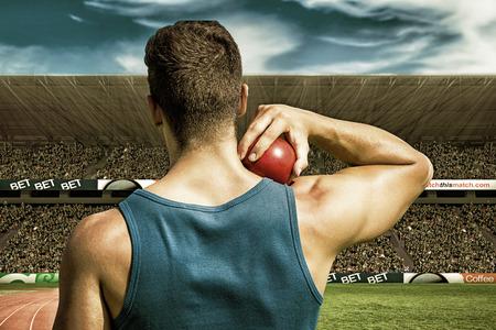 lanzamiento de bala: Rear view of sportsman practising shot put  against view of a stadium Foto de archivo