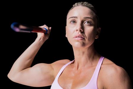 javelin: Female athlete throwing a javelin against black background Stock Photo
