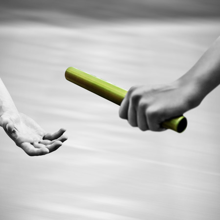 baton: Athlete passing a baton to the partner with colored baton