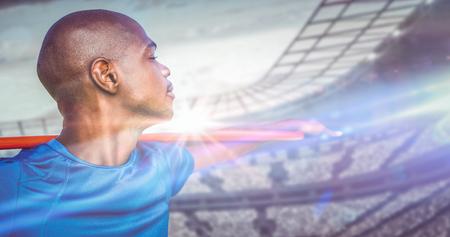 javelin: Close up of sportsman holding a javelin  against stadium