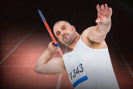 athletics track: Athlete preparing to throw javelin against focus of athletics track