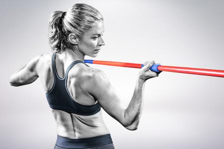 javelin: Athlete preparing to throw javelin against grey background