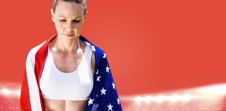 unsmiling: Portrait of american sportswoman unsmiling against red background Stock Photo