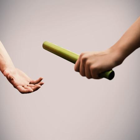 baton: Athlete passing a baton to the partner