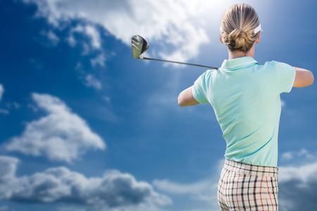 woman golf: Woman playing golf against blue sky