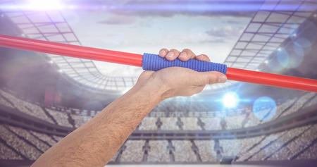 javelin: Male athlete holding javelin against stadium Stock Photo