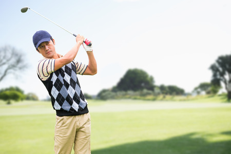 Man playing golf against view of a park Standard-Bild