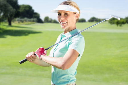 woman golf: Woman golf player looking the camera  against view of a landscape Stock Photo