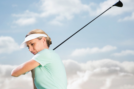 woman golf: Woman playing golf against cloudy sky Stock Photo