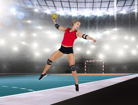 athleticism: Female athlete with elbow pad throwing handball against handball field indoor