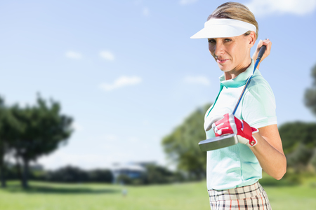 woman golf: Woman golf player looking the camera against view of a park Stock Photo
