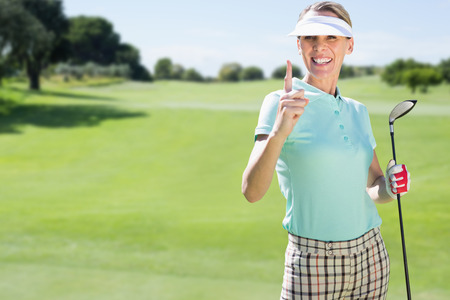 woman golf: Woman playing golf against view of a landscape