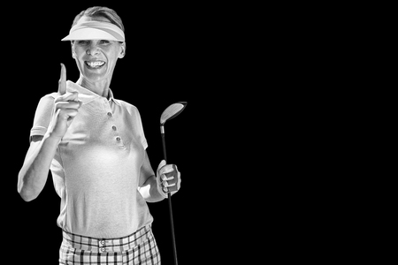 woman golf: Woman playing golf against black background