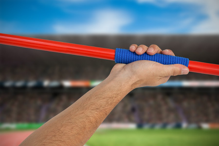 javelin: Male athlete holding javelin against view of a stadium Stock Photo