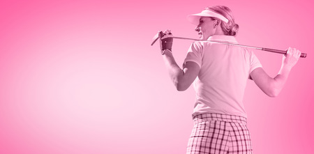 woman golf: Woman playing golf against pink vignette