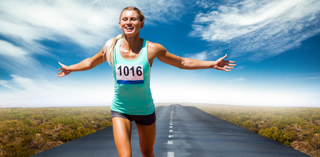 top animated: Sportswoman finishing her run against view of an empty street Stock Photo