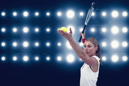 digitally generated image: Athlete holding a tennis racquet ready to serve  against digitally generated image of blue spotlight