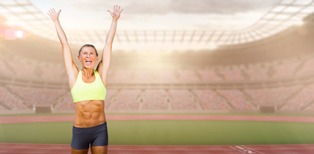 winning pitch: Woman cheering for success against view of a stadium