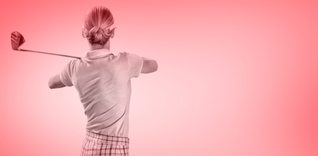 woman golf: Woman playing golf against red vignette