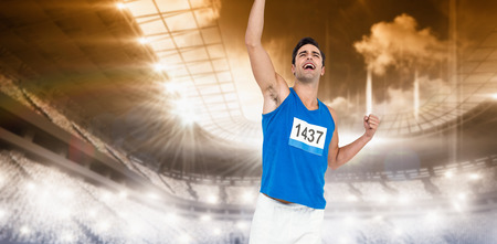 winning pitch: Male athlete posing after victory against sports arena Stock Photo
