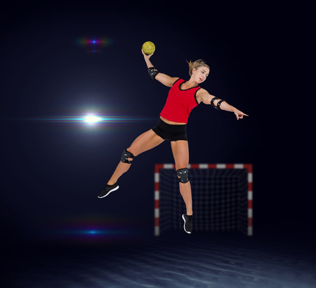 elbow pad: Female athlete with elbow pad throwing handball against view of lighting
