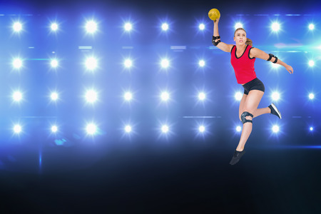 female elbow: Female athlete with elbow pad throwing handball against composite image of blue spotlight