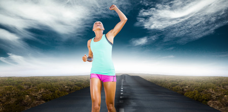 top animated: Sportswoman celebrating her victory against view of an empty street
