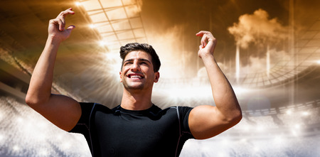 winning pitch: Portrait of happy sportsman  against view of a stadium Stock Photo