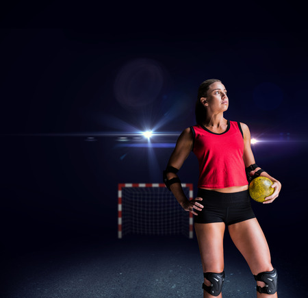 female elbow: Female athlete with elbow pad holding handball against view of lighting